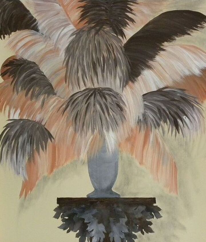 a vase of plumes on a stand