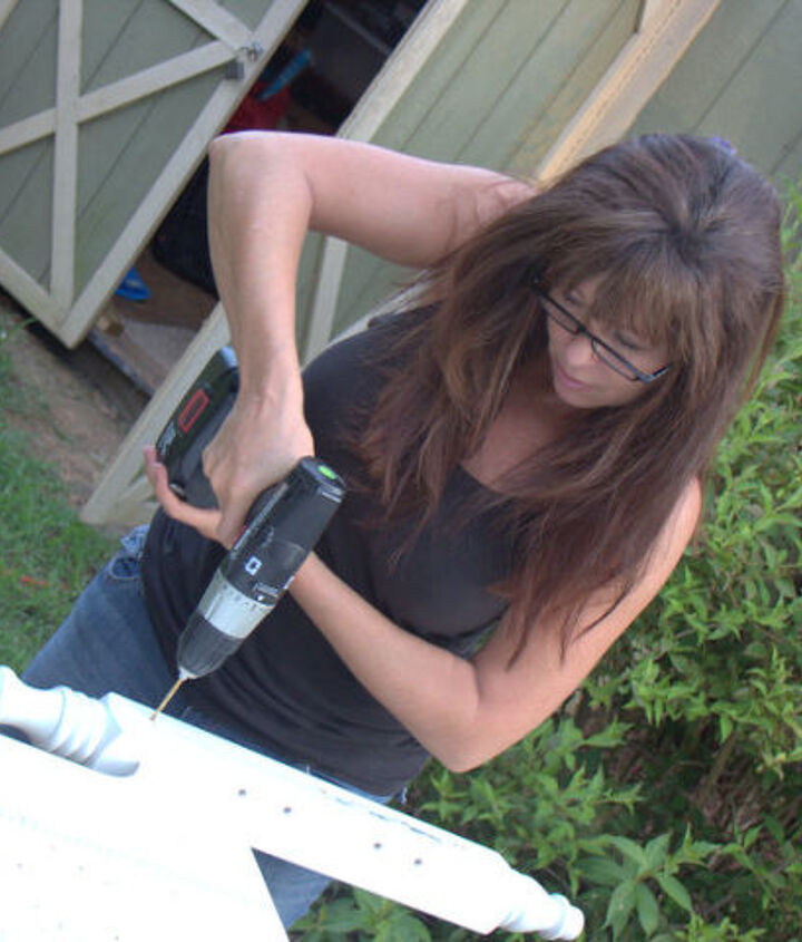 yours truly drilling holes for the wood dowels.