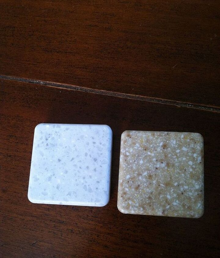 q white kitchen with speckled light gray or light sand colored coutertops, countertops