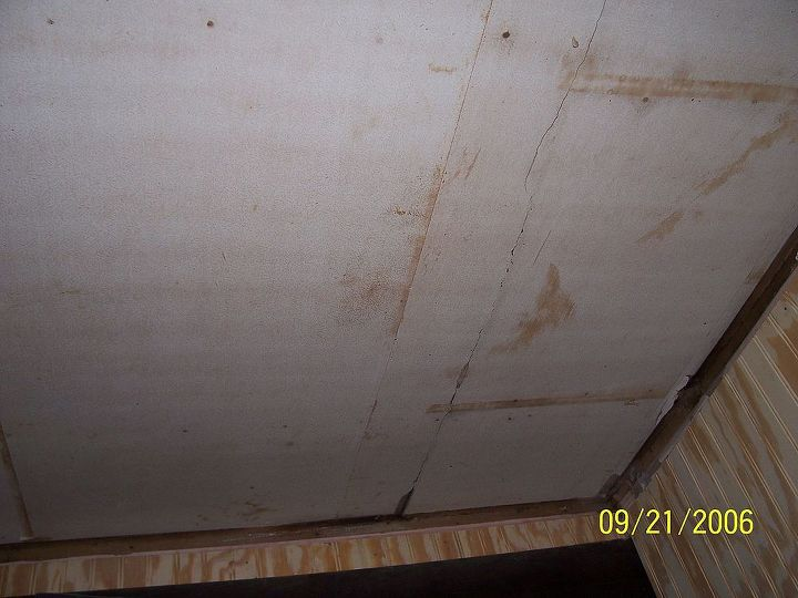 Before Ceiling unfinished drywall with wallpaper over it.  So Handyman installed lauan boards over it.