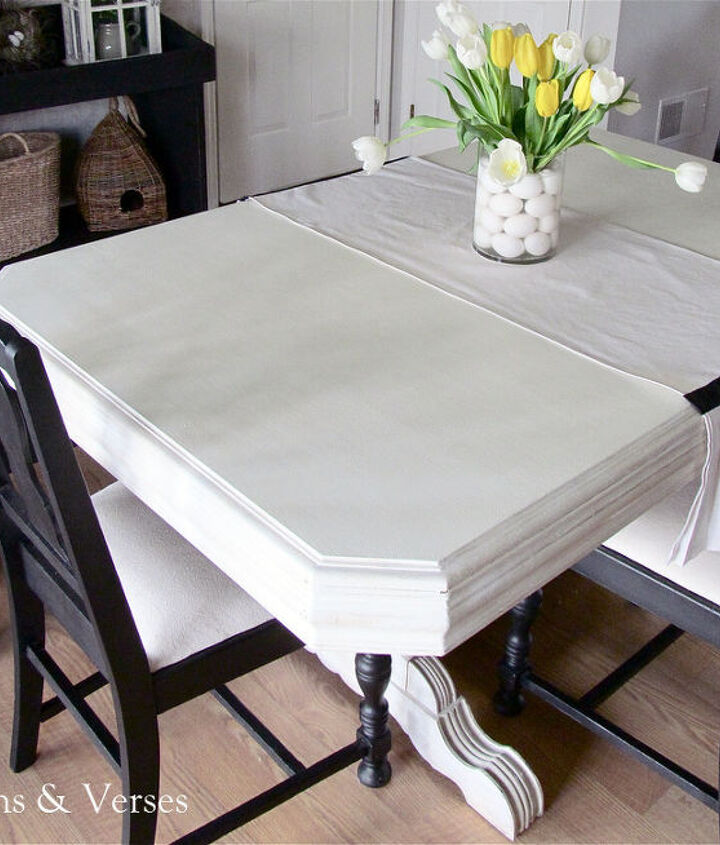 Chalk paint and wax on the skirt and legs of the table - water based poly for the top.