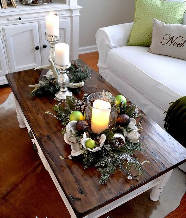 I kept our coffee table simple with candles and greenery ...