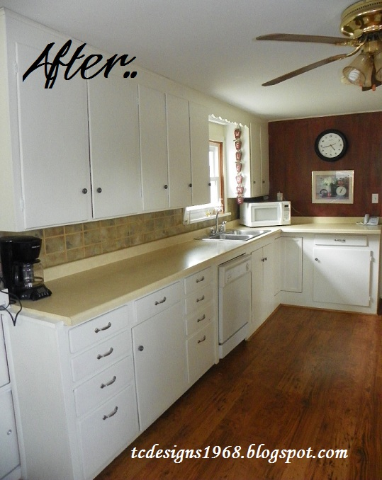 My kitchen after the transformation....Looks So much bigger and Brighter and all that was needed was a little paint :)