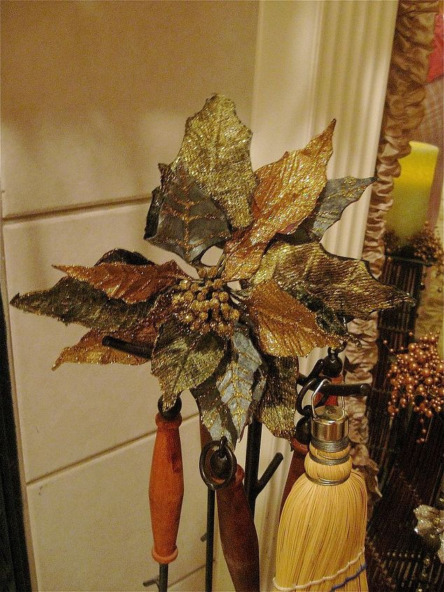 A simple poinsettia clip adorns the fireplace tools!