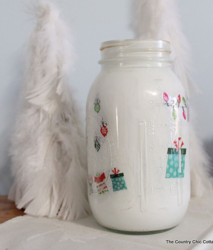 I used stickers to create my version of the jar.  http://www.thecountrychiccottage.net/2012/11/christmas-mason-jar.html