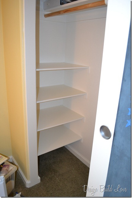 Next, I placed the shelves on top of the supports, and used finishing nails and a hammer to secure the shelves to the wall supports.  After that, I threw on two coats of high gloss white paint to finish them off!  Pretty, pretty!