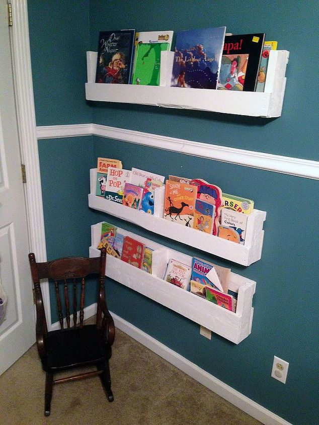 The 3 shelves were hung mostly behind the door so as to utilize the space and keep the books in a usable space but a little out of the way.