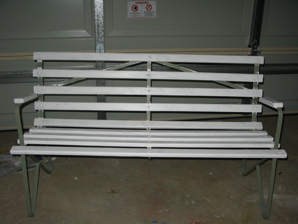 Wooden slats - paint stripped with heat gun, sanded and undercoated.  Metal frame treated with rust converter and then rust proof primer