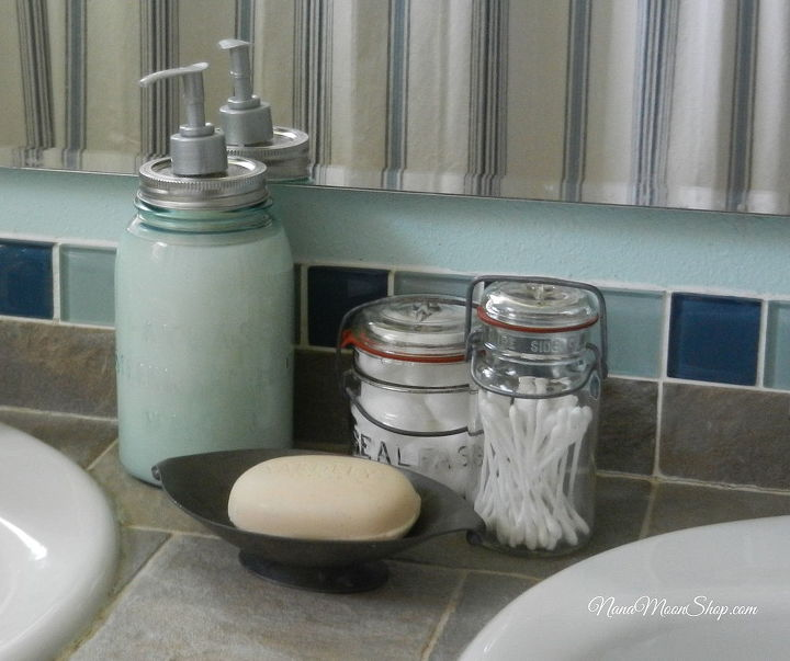 I used vintage jars for storage and fashioned a soap dispenser out of one.