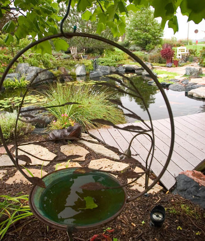 Garden art looks right at home in this watery wonderland.