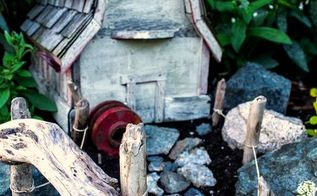 farm styled fairy garden with a birdhouse, flowers, gardening, ponds water features, A barn styled birdhouse plus found objects created this little garden theme http www funkyjunkinteriors net 2012 06 outdoor fairy garden farm style html