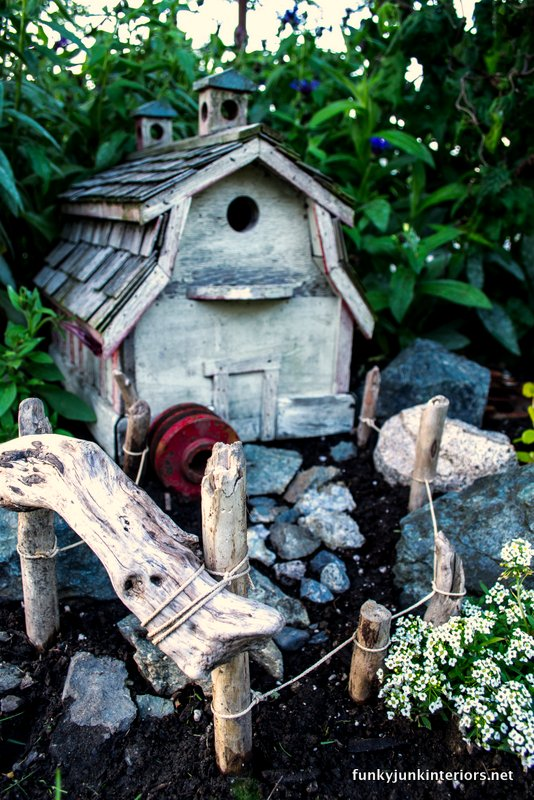 A barn styled birdhouse plus found objects created this little garden theme.http://www.funkyjunkinteriors.net/2012/06/outdoor-fairy-garden-farm-style.html