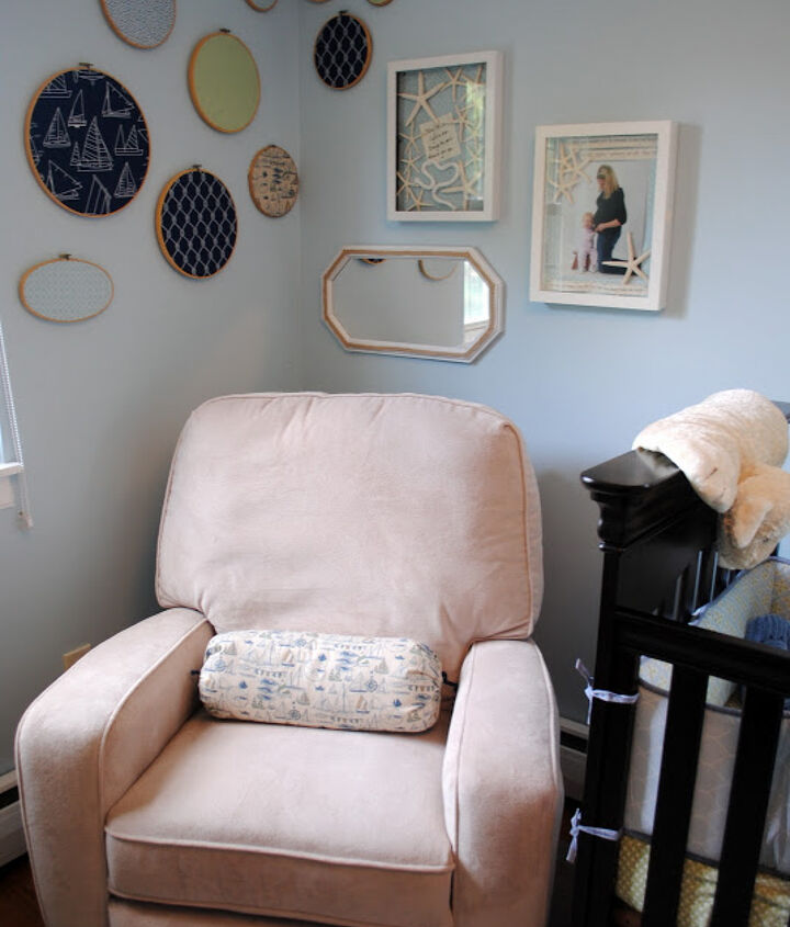 The AFTER!  Rope trimmed mirror, starfish shadow boxes, and a sailboat bolster provide tons of beachy looking comfort.