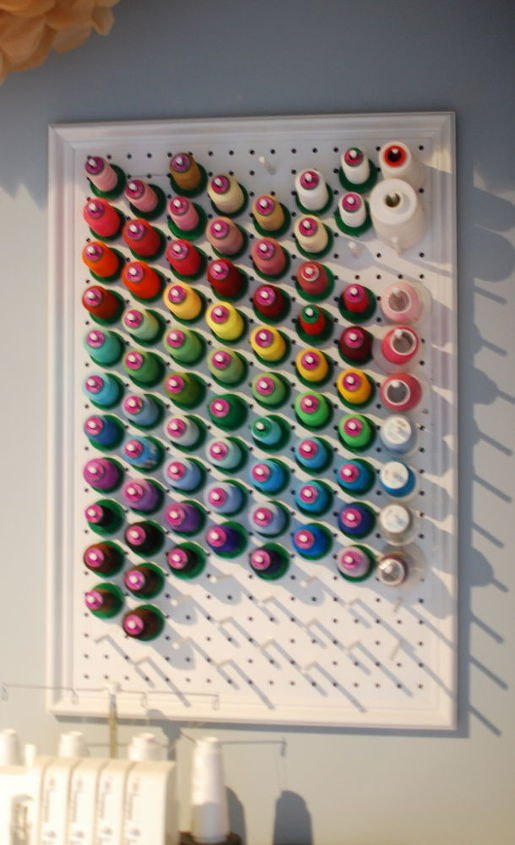 This thread rack was and easy DIY project using scrap pegboard and wood dowels.