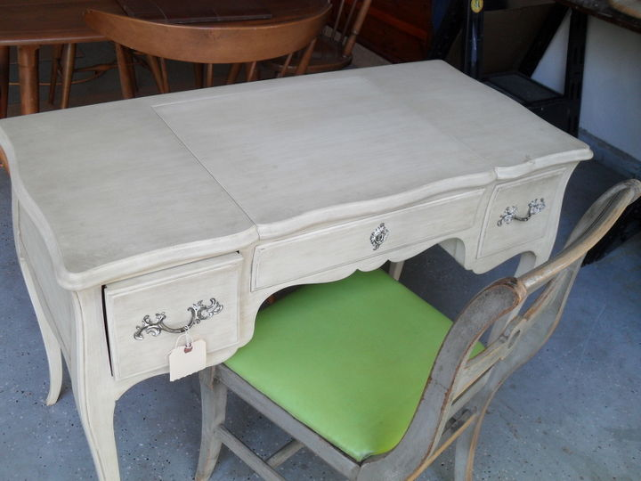 I scored this at an estate sale...but can't decide what color to paint it...not sure if I should go girly with pink or do something more adult like a grey or the very popular turqouise.