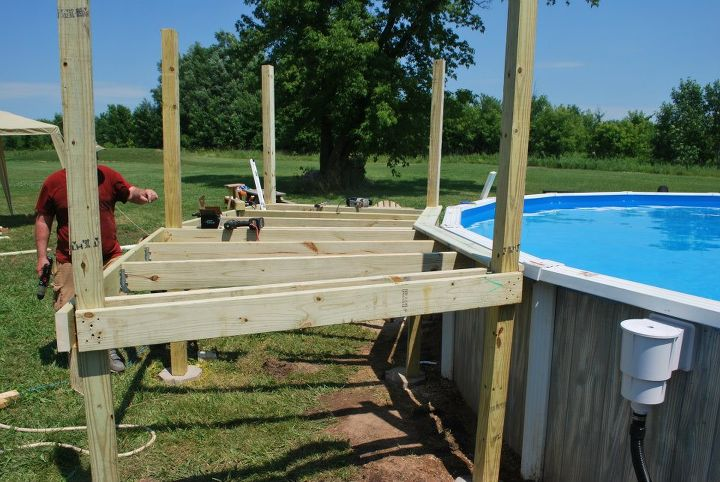 our pool deck project, decks, pool designs, First deck boards go on