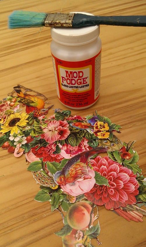 use some old fashioned glossy decoupage images to patch over any blemishes...