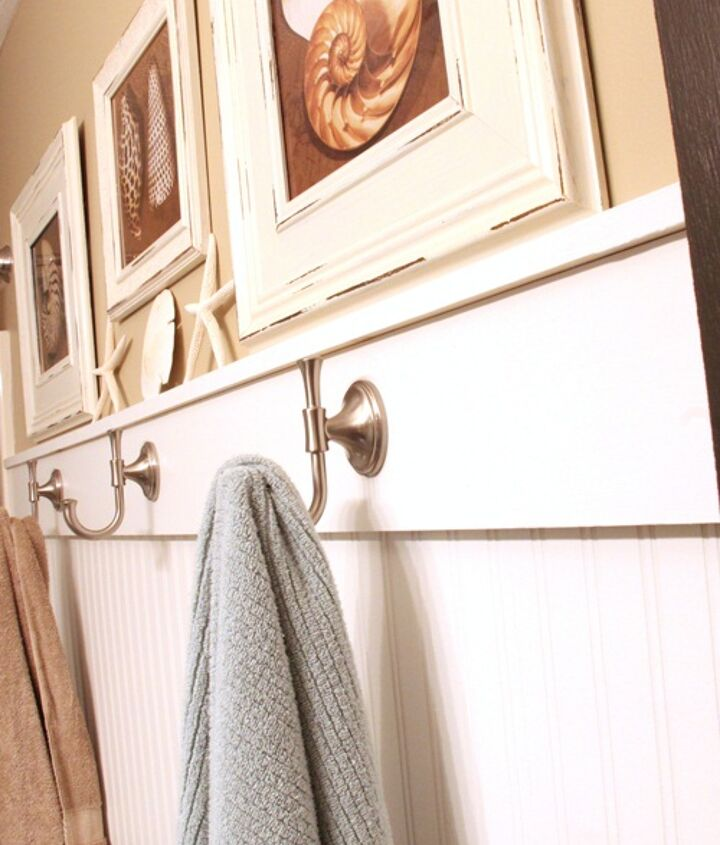 Beadboard wallpaper topped with real wood 1x6's and satin nickel hooks add lots of charm.