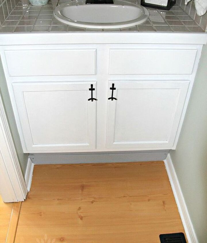 I painted the oak cabinets and used hooks from old hobby lobby number blocks for the handles.