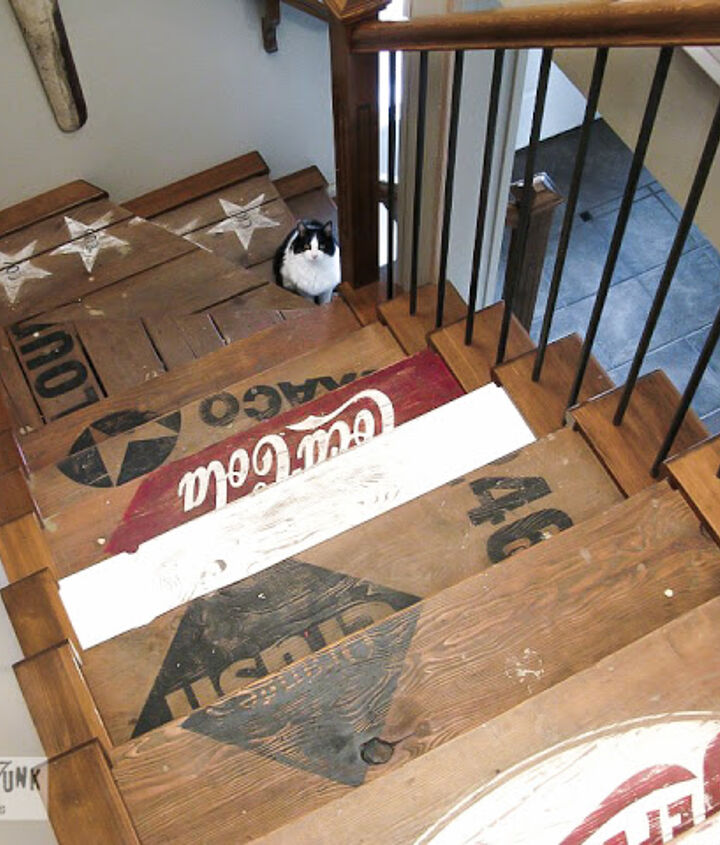 Not being able to afford to carpet my stairs, I painted them up instead, creating stencils out of decals with my signmaking equipment.