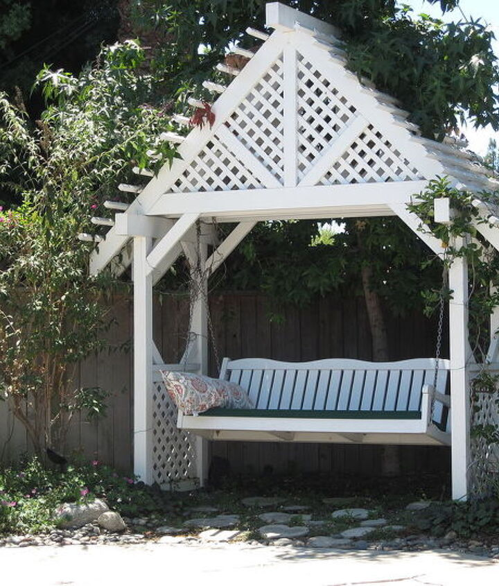 Arbor with a butterfly bush on left side and stephanotis flowers growing on both sides.