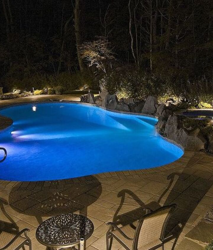 Blue glow from the LED lights in the pool at night http://www.deckandpatio.com/awards/Awards2008.html