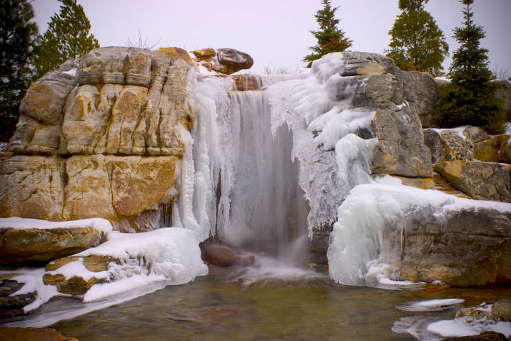 The waterfalls are partially frozen over during winter.