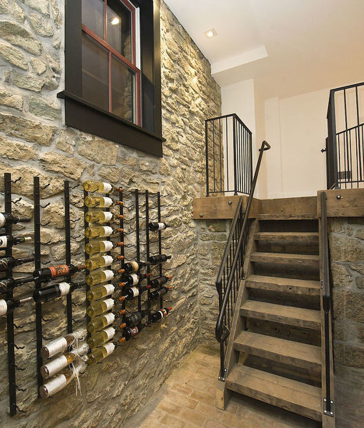 Originally the ice cellar in the sub-basement and converted into a wine cellar. The wooden staircase and band board were made from old floor joists salvaged during the renovation.