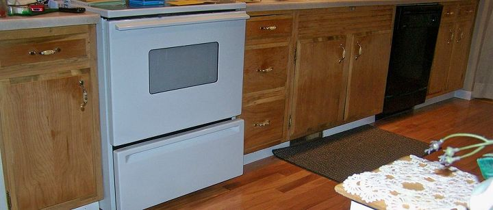 q we have all solid wood kitchen cabinets maybe mahogony not sure need to replace, kitchen cabinets