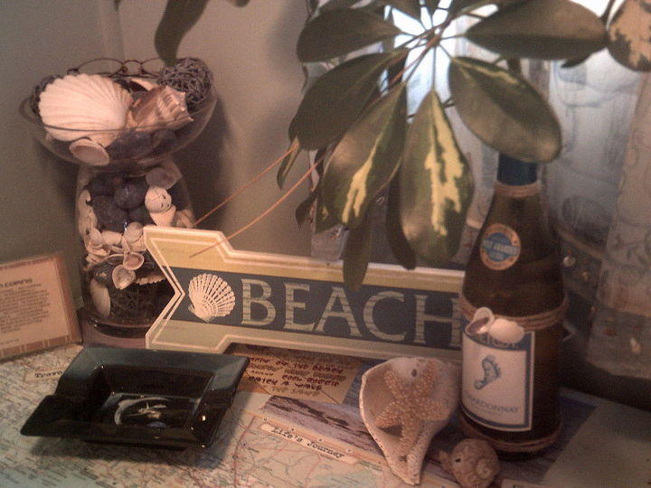top of my little dresser in bathroom covered in maps of Florida