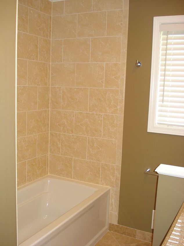 A tall glass shower door has been added since this was taken