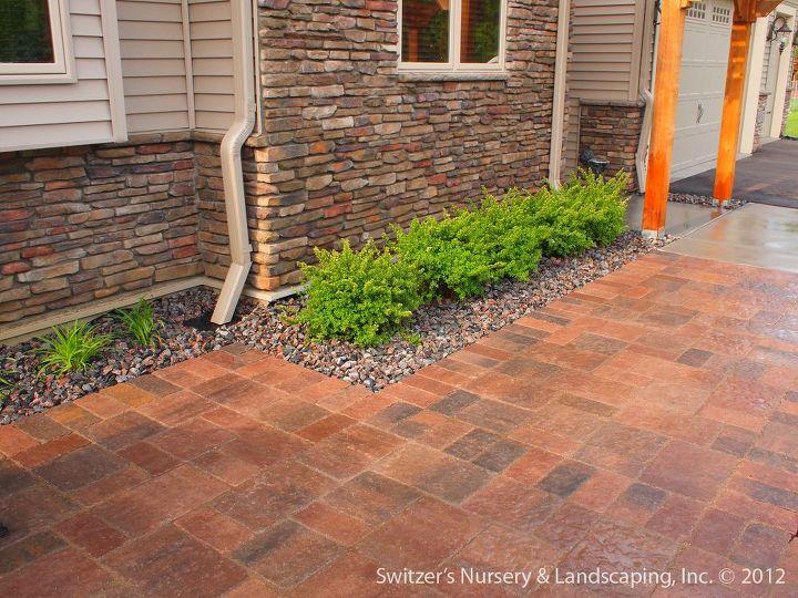 Interlocking concrete paver patio and walk.