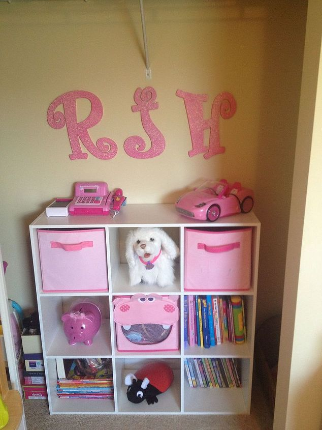 A cubbie storage system is used to organize my daughter's books, movies, and toys.