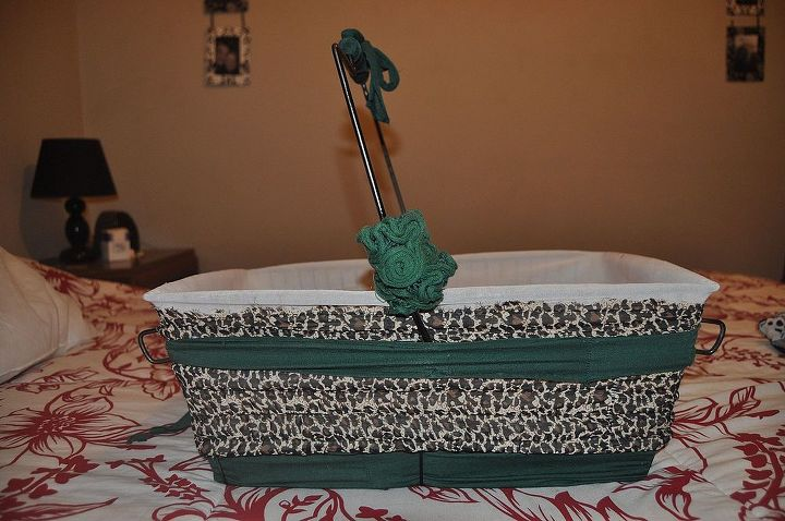 """old market basket that was going to the dumpster. i saved it, it was very rusty, so i sanded and painted it, and also """"dressed"""" it with old pieces of dresses"""