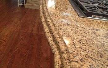 Granite counter tops with a double ogee edge.