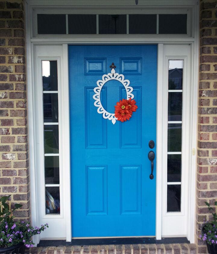 Blue Mosque front door with Orange Daisy Wreath