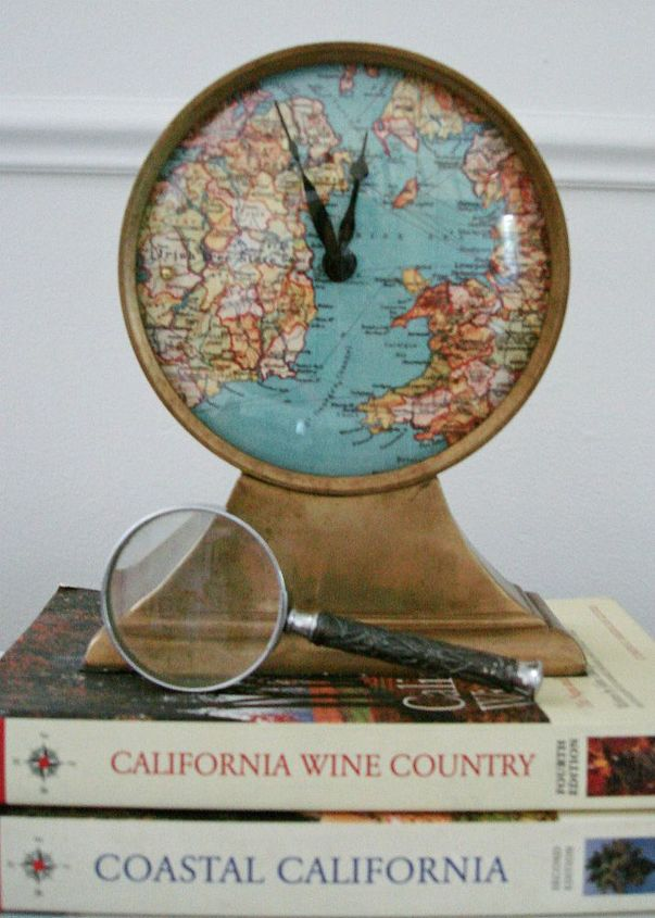 Replace the face of your clock with a map and add a bead or a pin to the exact location you want to remain timeless.