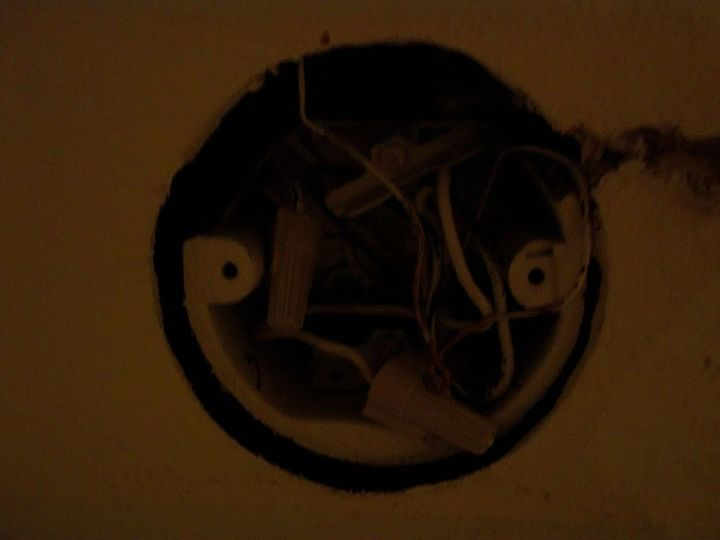 broken junction box that is above the sink. We replaced it and hung a new light.