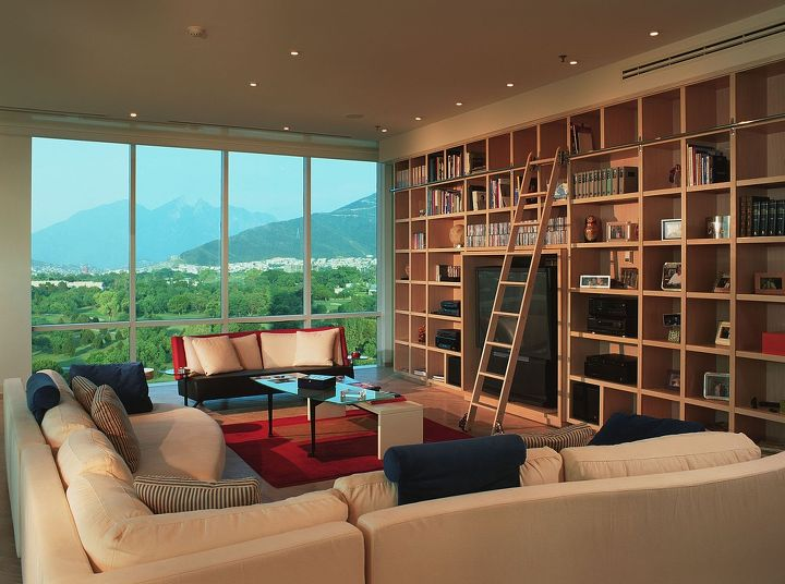 View to Country Club and mountain landmark. Rolling ladder on signature Cabinetry wall.