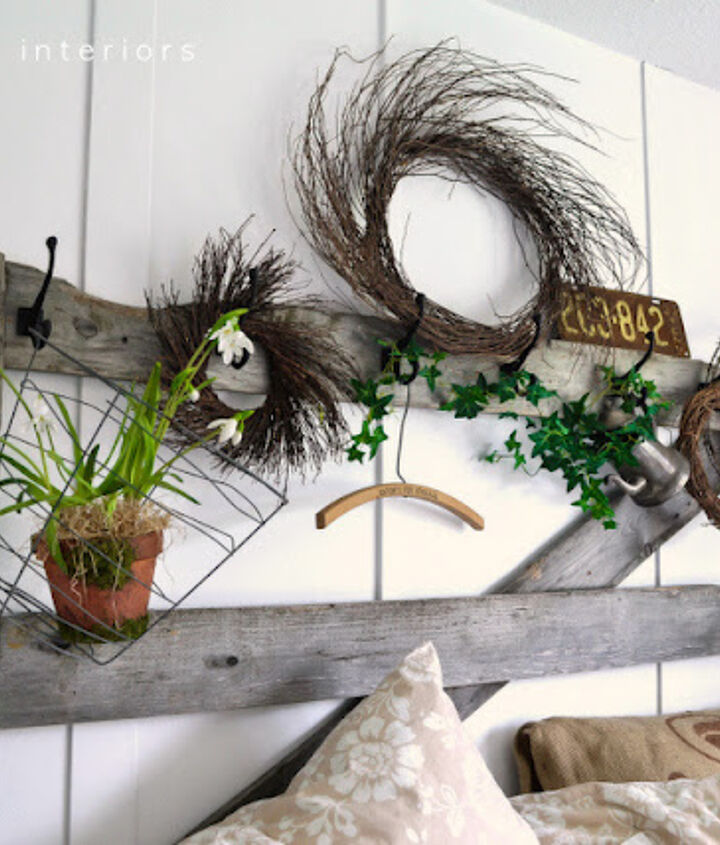 An old horse gate found on someone's burn pile is now my headboard with hooks, changeable with every season. Fun!  Visit post at: http://www.funkyjunkinteriors.net/2012/05/how-to-decorate-bedroom-with-messy.html
