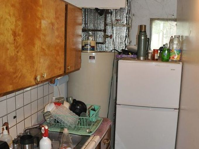 small kitchen makeover, home improvement, kitchen backsplash, kitchen design, Wall was right next to small fridge spliting the small window in two small sink no dishwasher no counter space ugly old tile in floor and on wall
