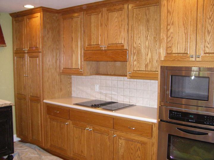 kitchen cabinet makeover, kitchen cabinets, kitchen design, painting, Oak cabinets before