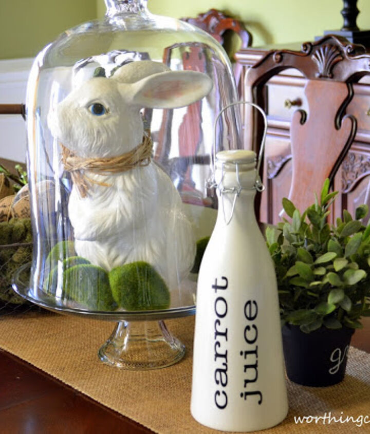 A bunny with a raffia bow tie is keeping his eye on this bottle of carrot juice.