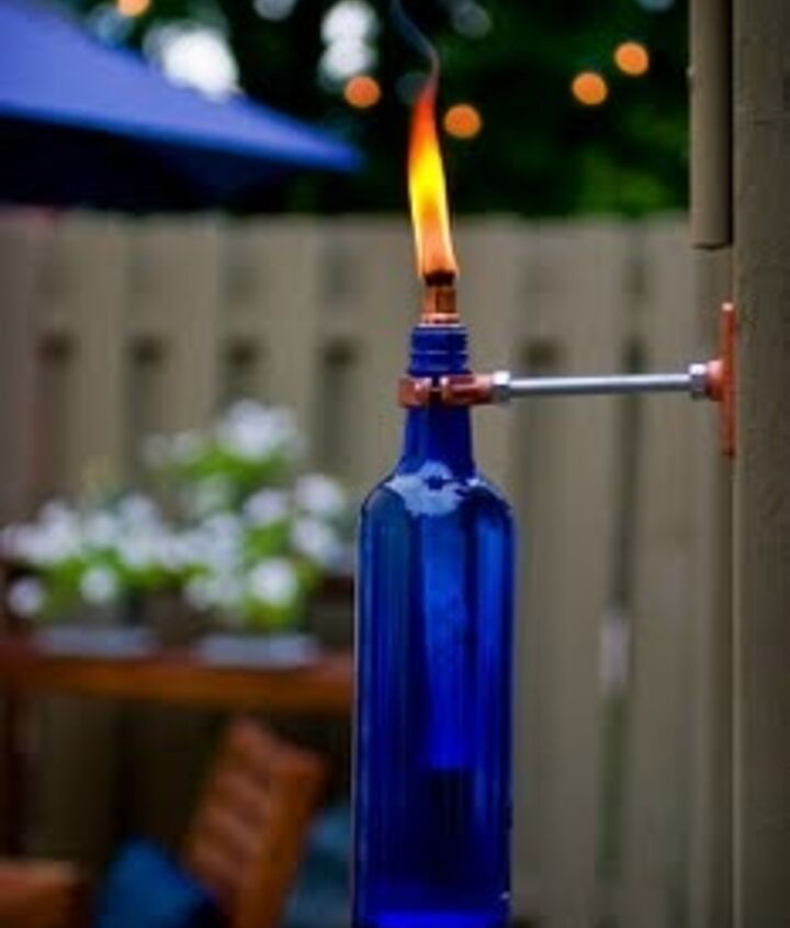 Recycled wine bottle torches