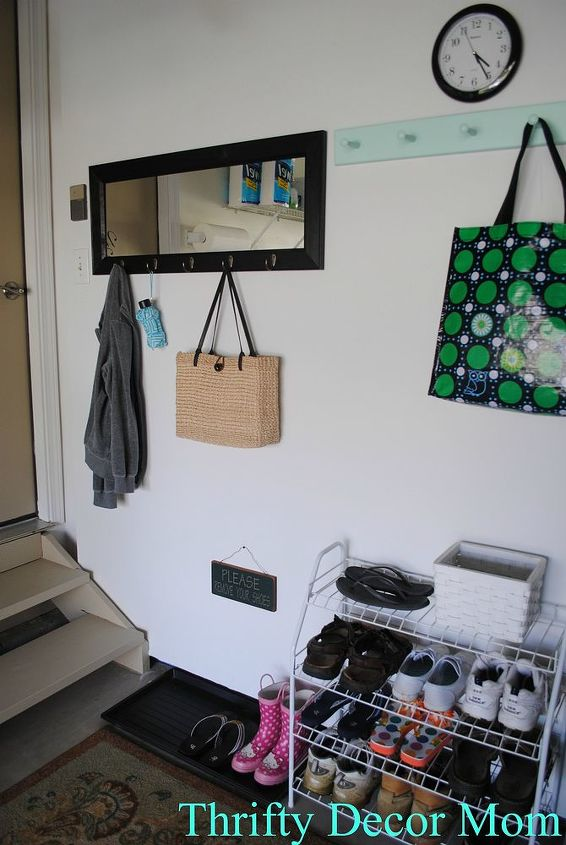 There are plenty of hooks for jackets & coats and my reusable shopping bags. Shoes are stored on the wire organizer and on a boot tray.