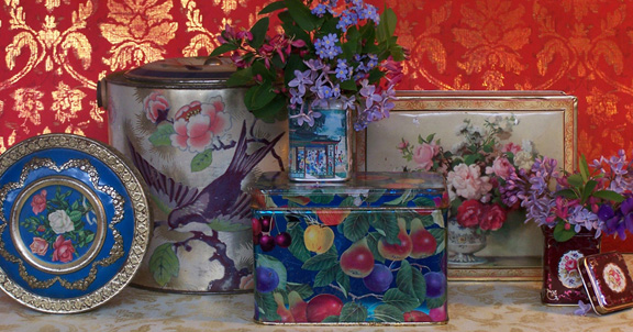 arranging flowers in vintage tins, flowers, gardening, home decor, repurposing upcycling