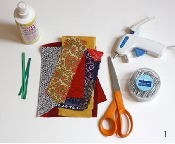 You need paper-clips, glue gun, scissors, small pieces of fabric.