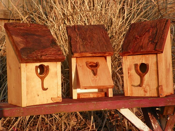 Bird houses with barn wood roof.