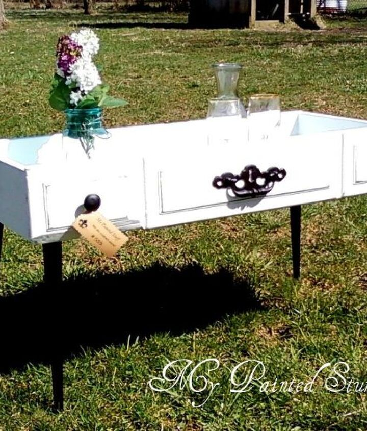 Painted & re-cycled into the cutest little table. Perfect in the sun room or next to your favorite chair.