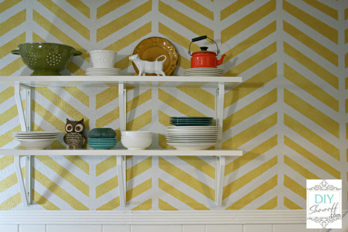 IKEA Ekby shelving and brackets - display dishes and accents leaving valuable cabinet space for food and not-so-pretty dishes/containers in this small kitchen.
